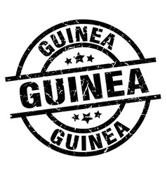 guinea black round grunge stamp vector image