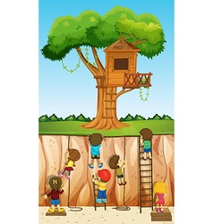 Children climbing up the cliff vector image