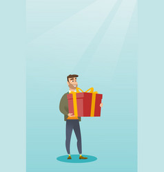 young caucasian man holding box with gift vector image