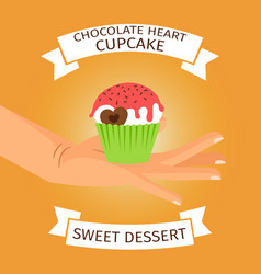hand holding cupcake with chocolate heart vector image