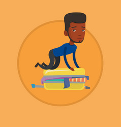 young man trying to close suitcase vector image