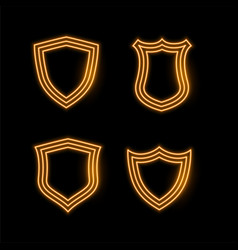 Four golden neon shield icons vector