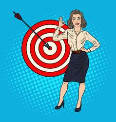 Pop art businesswoman achieved the target vector