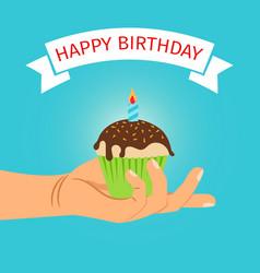 hand holding cupcake birthday vector image vector image
