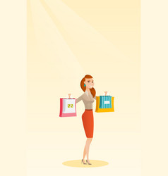 Young caucasian woman holding shopping bags vector