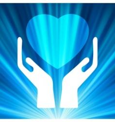 Heart in open hands vector