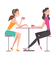 beautiful girls sitting in cafe and talking to vector image