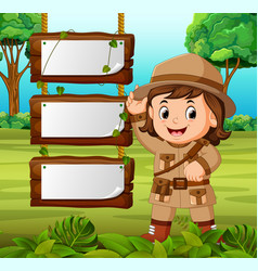Young girl adventurer with blank wood background vector