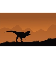 Silhouette of T-Rex in the fields vector image