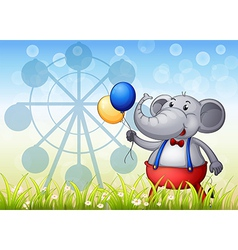 An elephant with balloons in front of the ferris vector