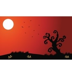 Silhouette of dry tree and bat halloween vector