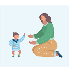 mother playing with her little son on the floor vector image