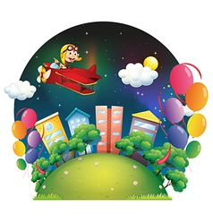 A city with balloons and airplane vector image vector image