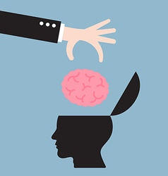 Businessman hand put brain in human head vector