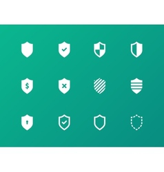 Shield icons on green background vector image