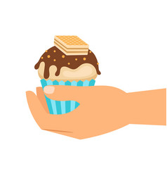 hand holding wafer cupcake vector image vector image