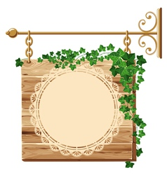 Wooden sign with ivy vector image vector image