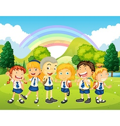 Children in uniform standing in the park vector image vector image