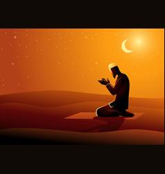Muslim man praying in desert vector