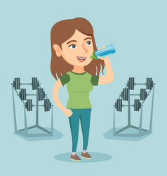 Young caucasian sportswoman drinking water vector
