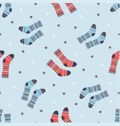 Winter pattern with warm socks vector
