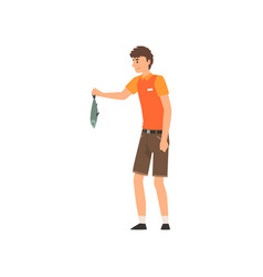 Zoo worker holding fresh fish to feed animals vector