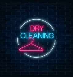 Neon dry cleaning glowing sign with hanger in vector