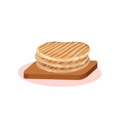 Grilled wheat cakes on a wooden board bulgarian vector