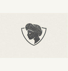 shield shaped badge with silhouette head vector image