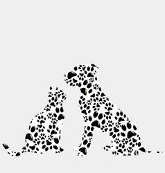 silhouettes of cat and dog in paws pattern vector image