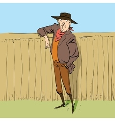 Cowboy in full figure standing near a fence vector image