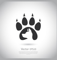 Icon with dog footprint and dogs head inside it vector