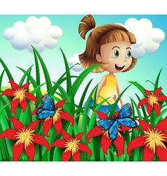 A small girl at the flower garden with butterflies vector
