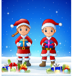 cartoon boy and girl bringing gift box in the wint vector image