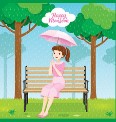Woman under umbrella sitting on bench in park vector