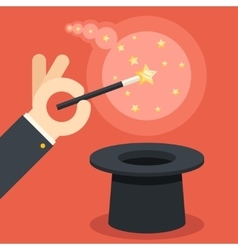 Magician hand holding magic wand over cylinder hat vector