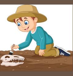 cartoon boy brushing a dinosaur fossil vector image