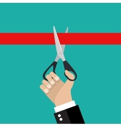 Human hand holding a pair of scissors vector image