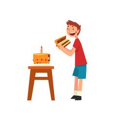 cute happy boy eating birthday cake vector image