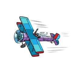 Retro airplane with a female pilot pop art vector