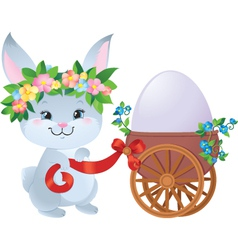Easter Bunny with a small cart and an egg vector image