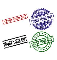 Damaged textured trust your gut stamp seals vector