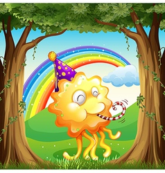 A happy monster at the forest vector image