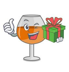 With gift cognac ballon glass mascot cartoon vector