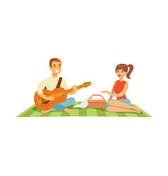 Young man playing guitar to his girl on a picnic vector