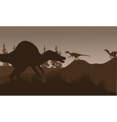 Silhouete of spinosaurus and eoraptor in hills vector image