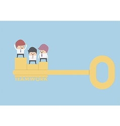 Businessman stand on the golden key Teamwork Conc vector image vector image