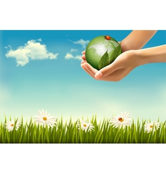Nature background with hands holding a globe vector