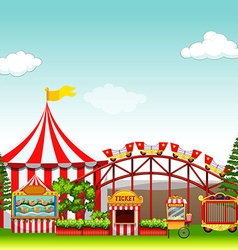 Shops and rides at the amusement park vector image