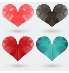 Set of polygonal colored hearts on a gray vector image